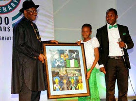 Ayomikun presenting a painting work to Nigerian President Goodluck Jonathan in Abuja: Kunle Adewale presenting her to the President